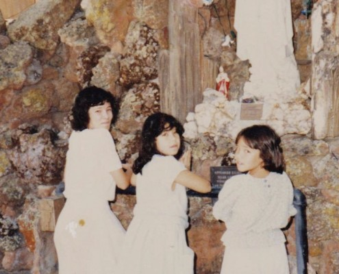 Angela and her sisters pray together on Sundays. They are Chinese-American Catholics.