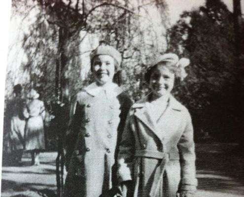 Two best friends enjoy a walk in the park - 1930s