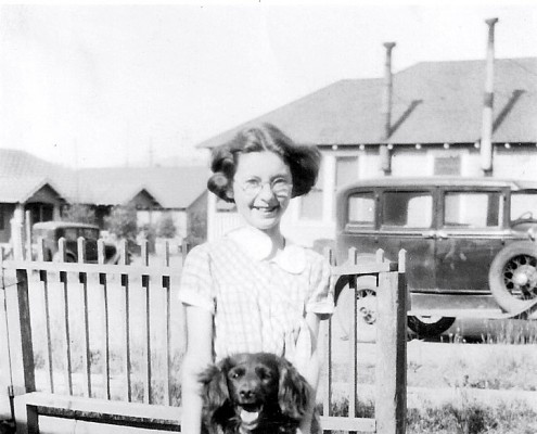Jo-Ann has fun with her furry friend, an Irish Setter. (Chapter 3 - 1930s)