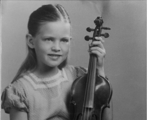 Young girl poses with contented kitty and violin. (Chapter 4 - The 1940s)