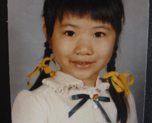 First-generation Chinese American, Amy wears two braids for her school portrait.