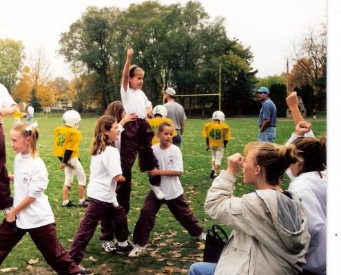 Brianna becomes a cheerleader in third grade.