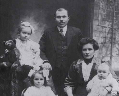 Mary Ann and family miss boarding the Titanic by minutes in 1912. Here, they pose for the camera.